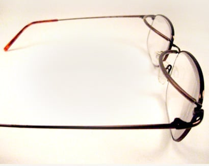 Eyeglass modification with crutches to support Ptosis patients